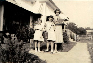 Aunt Joyce, Mom, Aunt Rena.  This may be a 1st day of school picture.