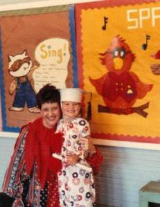 """Mom with one of her kindergarten graduates.  Their graduation theme must have been """"clowns."""""""