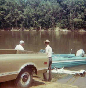 """Mom wrote """"old boat, new truck"""" on the back of this photograph."""