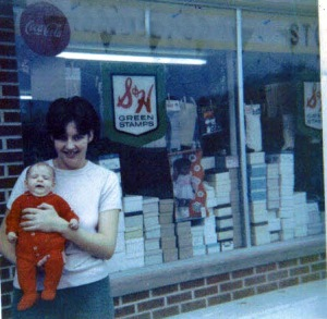 Mom with baby me in front of Gihon Grocery.