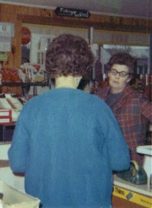 Aunt Dossie talking with Gramma Findley in the store.