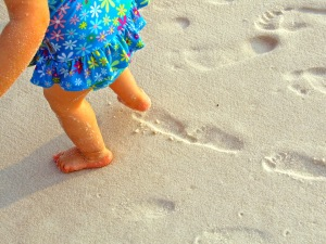 Footsteps in the sand.