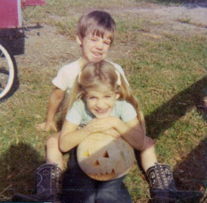 My brother and I with a carved pumpkin.
