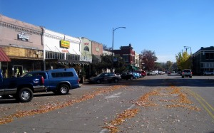 Leaves falling all over the road before the cars can chase them off.  Small Alabama town.
