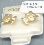Gold earrings.