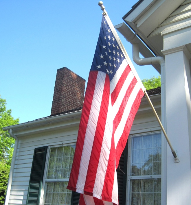 American Flag at entrance to Ivy Green.