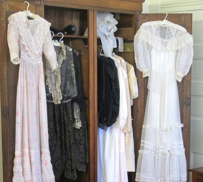Helen and Mrs. Keller's clothing in wardrobe.  Upstairs bedroom.