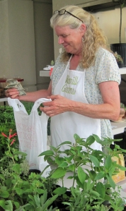 This lady from Windmill Gardens was selling herbs.