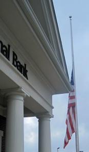 United States of America flag at half mast.