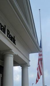 United States of America flag at half mast.