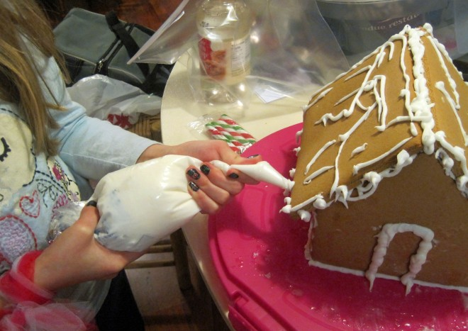 Princess Buttercup decorates her gingerbread house.