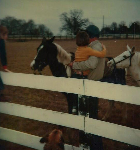 Climbing the fence in a flurry of hugs, explanations, and warm ponies.