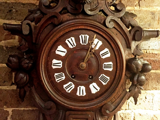 """Black Forest carved wall clock circa 1880 with high-quality French movement that runs 14 days on a winding..."""