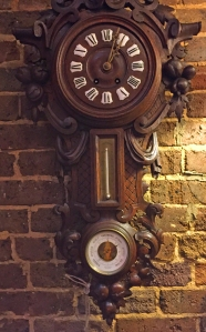 Black Forest carved wall clock, Magnolia Antique Gallery.